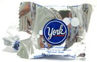 """The """"York"""" ~ cool & refreshing bite-size mint! The miniature version of the classic cool & refreshing soft York Peppermint Patty; covered in rich dark Chocolate and individually wrapped in silver foil."""