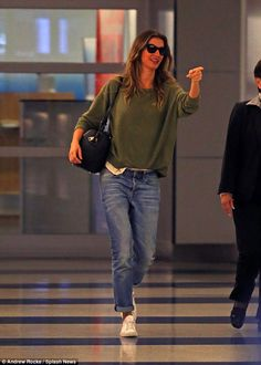 Comfy and casual: The 36-year-old star looked lovely as ever in a khaki jumper teamed with...