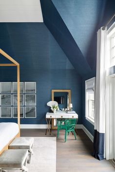 Dramatic dark blue painted walls and vaulted ceiling.