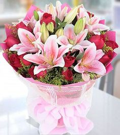Grace & Beauty Pink Bouquet surprise with Pink lilies and Red roses (25+ Flowers). Free Message Card