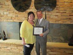 General manager Scott Krause awards Sam Becker with her People Pleaser Award.