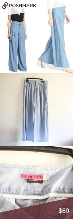"""Alice + Olivia Wide Leg Chambray Pants Lovely, wide leg pants with belt loops and pockets. Great condition. No holes or stains.  Size: 8 Material: 98% cotton, 2% elastic Measurements: Waist """" 30"""", Inseam """"33"""", Length """" 43""""  **Feel free to message me asking any questions.  * All items are measured laying flat then doubled  * Comes from a smoke-free home Alice + Olivia Pants"""