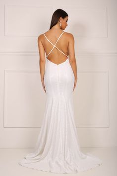 Backless design of white sequinned mermaid evening gown with deep v neck and crossover thin back straps