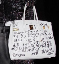 Lady Gaga's white Hermès Birkin was seen with Japanese words written on it.