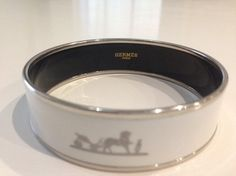 Hermes Wide Caleche Enamel Bracelet. Get the lowest price on Hermes Wide Caleche Enamel Bracelet and other fabulous designer clothing and accessories! Shop Tradesy now