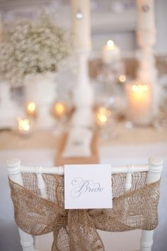 simple burlap bow and bride and groom sign maybe add dark purple and green accent