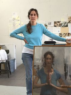 The artist with one of her self-portraits Carolyn Pyfrom