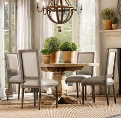 Neoclassical style dining by Restoration Hardware