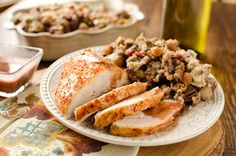 Crock Pot Turkey Breast with Cranberry Sauce is the BEST turkey recipe! Turkey breast is brined & slow cooked for a flavorful & crazy juicy piece of meat.
