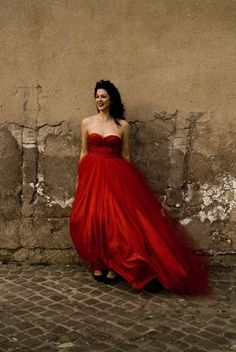 Red evening gown in contrast to the degrading wall. Snow White wakes up to disrepair.