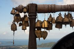 Buddhist bells with Andaman sea in the background.