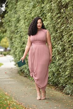 Girl With Curves blogger Tanesha Awasthi wears a lace detail plus size maxi dress and emerald accessories.