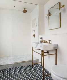 Two of my loves side by side BRASS PATTERN TILES. Loving the soft curves on…