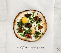Cauliflower Crust Pizza with Fried Eggs via Love and Lemons.