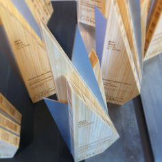 Custom awards made from sustainable and eco friendly materials. Bamboo and aluminium.