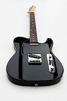 Black telecaster...I like the dark stripes caused by light reflection- gorgeous!
