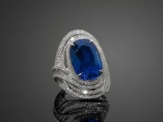 A sapphire, diamond and 18k white gold ring, by Leysen, accompanied by a Gubelin certificate stating that the 17.52 cts sapphire, origin Burma, shows no indication of heating.