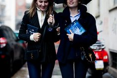 Two fashion editors walking on the street before the Dolce&Gabbana Fall 2016 fashion show in Milan, Italy