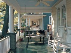 Beautiful southern front porch. Love the paint colors on the floor and ceiling of this porch.