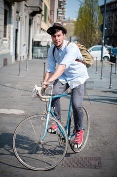hipster young man on bike in the city Stock Photo