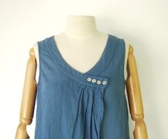 (way to alter a too large scoop neck, while angle will preserve ease of drape at the bottom) Lovely button detail