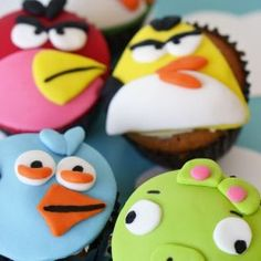 Fondant makes so many neat design ideas possible with cakes and cupcakes...even turning them into Angry Birds! With just 6 or 7 basic colors of fondant, the folks at Bake For Happy Kids created these masterpieces of digital gaming for a 3 year ol