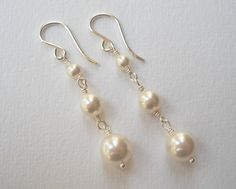 ***These earrings can be ordered in multiples! Please contact me if you need more than one.    Three Swarovski pearls, graduating in size,