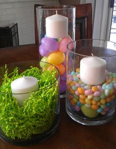 Easter centerpiece use three smaller glass containers. One with easter grass, two with jelly beans, white candles