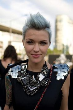 this grey hair trend is so hott.  she looks so tough and so ladylike at the same time. THAT ROCKS!