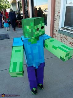 My son Roland is wearing the costume I made. We got the idea from my nephew Jaxon, who plays mindcraft on his Roland became interested so I decided to build him a costume. It took probably about a month because I'm workng two jobs. Girl Zombie Costume, Zombie Halloween Costumes, Easy Halloween Costumes, Cool Costumes, Halloween Couples, Group Halloween, Homemade Costumes, Homemade Halloween, Family Costumes