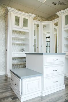 Decorative wallpaper becomes an accent in this backless design, while a closet island w/ drawer storage adds function & sophistication. Learn more here: https://www.closetfactory.com/custom-closets/