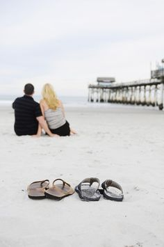 Simple beach engagement photo shoot. Sandals in the sand