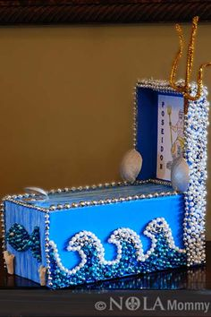 Mardi Gras beads make waves- Shoe box parade float