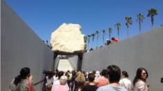 "LACMA head Michael Govan led a public dedication ceremony in front of hundreds of eager art devotees at 11 a.m. on Sunday, June 24, to mark the debut of earthworks artist Michael Heizer's ""Levitated Mass."" The 340-ton megalith at its center drew international attention in March when it was moved through 22 cities over 11 nights via a specially constructed transporter from a Riverside quarry."