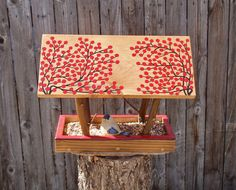Persnickety Bird Feeder - Covered Bridge style Open Air Persnickety Bird Feeder in Twigs and Winter Red Berries built with Reclaimed Wood and Branches - Song Birds, Bird Watching  This lovely handmade and hand painted Bird Feeder is a unique addition to your outdoor garden! The birds will love it and it is great in any landscape. The feeder is a beautiful open air Covered Bridge style design. Both sides of the roof is painted with twigs and winter red berries on the corners and the edge of…