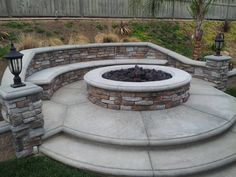 Natural gas stone firepit. Stone veneer. 6 foot round firepit with bench. Stamped concrete and bullnose concrete done by my neighbor.