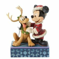 Mickey mouse  and pluto santa best frends