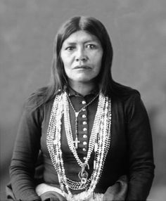 Tah-Das-Ti or Tah-Dos-Ti or Tah-Don-Ti, Wife of Old Coonie, in partial native dress with ornaments. Chiricahua Apache woman, 1898.