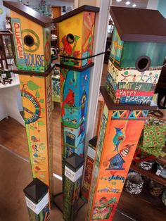 Peace pole bird houses with original art by Stephanie Burgess reproduced on fade-resistant PVC. Garden Crafts, Garden Projects, Peace Pole, Garden Poles, Pole Art, Bolster Dog Bed, Outdoor Art, Outdoor Gardens, Totems