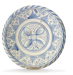 AN ENGLISH DELFT BLUE-DASH BLUE AND WHITE DISH CIRCA 1680, POSSIBLY LONDON OR BRISLINGTON The center with a four-petal flower, the border with rays of San Bernardino on a scroll ground within a blue-dash rim China Plates, Plates And Bowls, Delft, Earthenware, Stoneware, Architecture Collage, Antique Pottery, White Dishes, Pottery Making