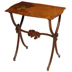 An Emile Galle mahogany and Fruitwood marquetry inlaid side table. Signed in marquetry Galle.