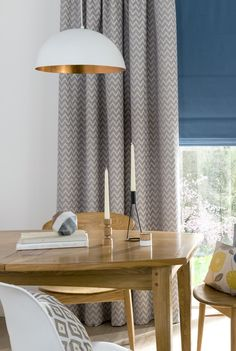 Add rich blues and intricate patterns to an otherwise simple interior to add interest. Our Horizon Mist fabric for Roman blinds and curtains is the perfect choice for creating those Scandi vibes.