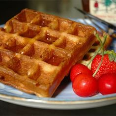 Belgian Waffles Recipe - The yeast in these eggy waffles makes for exceptionally deep pockets, perfect for capturing melting butter and syrups. Classic Waffle Recipe, Great Recipes, Favorite Recipes, Popular Recipes, Delicious Recipes, Belgium Waffles, Good Food, Yummy Food, Pancakes And Waffles
