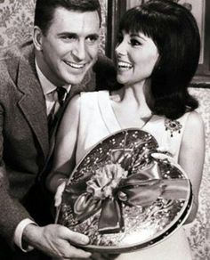 """Ted Bessell and Marlo Thomas, stars of the television comedy """"That Girl"""" (1966 to 1971), with a heart-shaped candy box."""