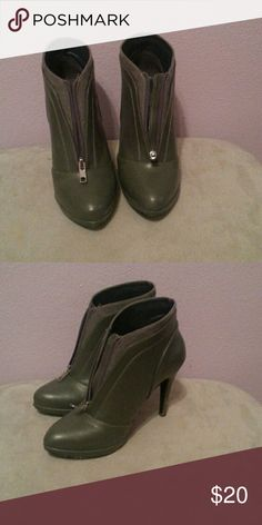 Nine West booties Grey Nine West booties zip up the front. Worn a handful of times. No obvious signs of wear Nine West Shoes Ankle Boots & Booties