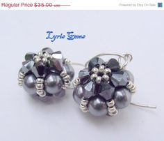 ON SALE Swarovski Crystal and Pearl Earrings by lyrisgems on Etsy, $28.00 #onfireteam #lacwe #jewelry