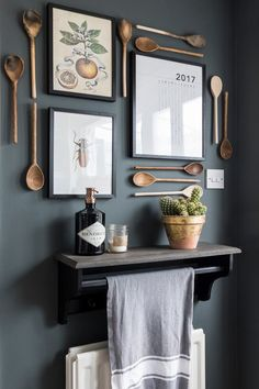 Create Pretty Vignettes to Lighten Your Spirit - Town & Country Living - Nature Prints and Wooden Spoons Create Display on Kitchen Wall - Kitchen Wall Art, Kitchen Decor, Kitchen Vignettes, Kitchen Wall Decorations, Kitchen Wall Design, Kitchen Gallery Wall, Kitchen Art Prints, Kitchen Display, Kitchen Walls