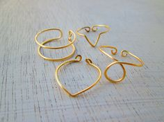 knuckle rings  set of 4 knuckle rings  adjustable by koskykon, $8.50