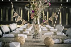 Rustic Fall barn wedding.  DIY idea for table decorations using twine, burlap, and dried flowers.  Each table was a name of a potato variety grown on the farm. Photo credit: http://www.seankmaxwell.com/