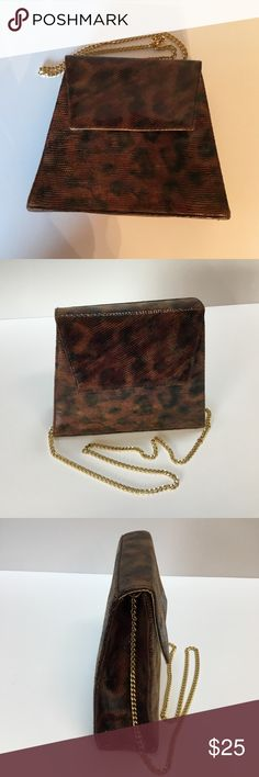 Exciting Timothy Hitsmen Bag i usually ship in 24 to 48 hours.  Fashionable Brown Shoulder Bag with muted shades of Browns.  9.50x8.25x3 inches.  Has gold shoulder chain.  Magnetic snap design.  Made in Spain.  Hardly worn.  Very Good Condition. Timothy Hitsman Bags Shoulder Bags